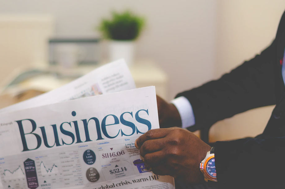 Man reading business news | Commercial Insurance