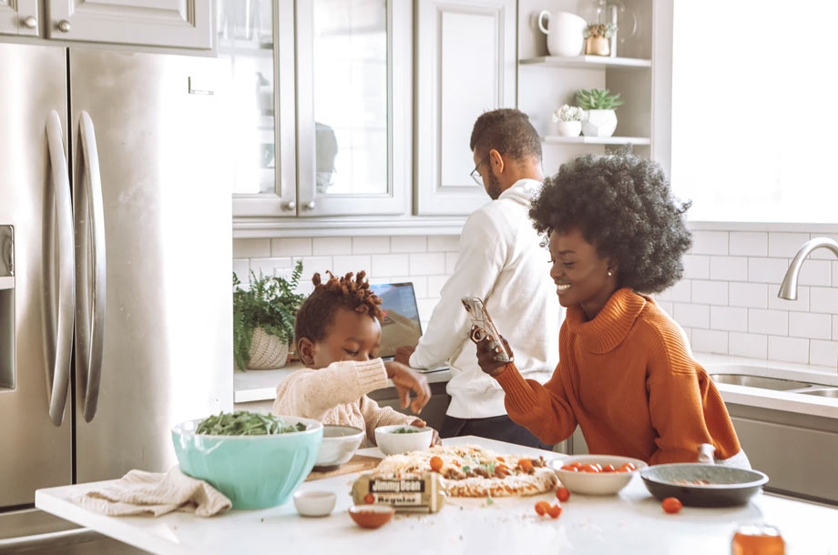 Young family with child in kitchen | Life Insurance